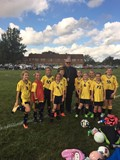 Bishop Perez visits 4th grade soccer game.